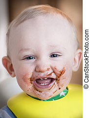 Baby with messy face, food.