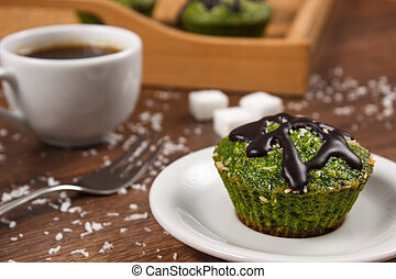 Fresh muffins with spinach, desiccated coconut, chocolate...