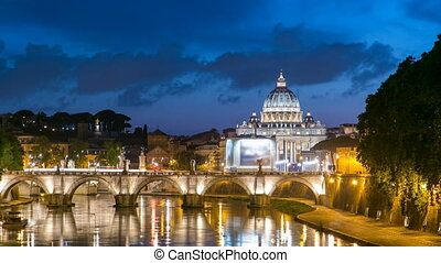 Rome, Italy: St. Peter's Basilica, Saint Angelo Bridge and Tiber River after the sunset day to night timelapse