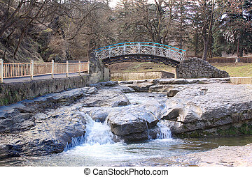 Bridge across the river Olkhovka in city Kislovodsk -...