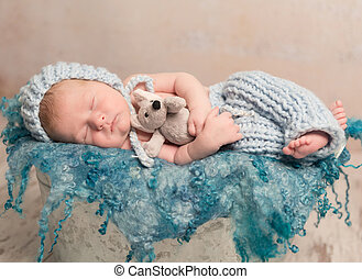 beautiful newborn baby sleeping on woolen blanket -...