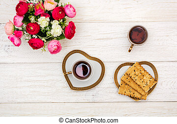 cup tea and cookies on white boards, top view