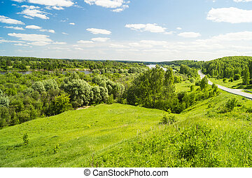 Spring landscape of the nature on background blue sky