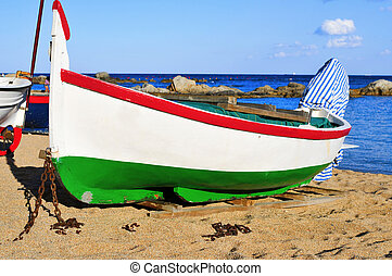 old fishing boat stranded in Calella de Palafrugell, Costa...