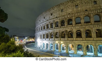 view of Colosseum illuminated at night timelapse hyperlapse...