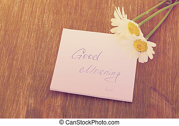 """Daisy flower and piece of paper with text """"good..."""