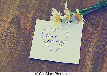 "Daisy flower and piece of paper with text ""good..."