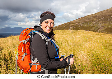 Female hiker posing at the foot of Carrauntoohil - Female...