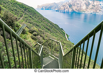 Panoramic iron staircase on Lake Garda along the trail from...