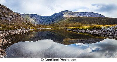 Reflection of the Macgillycuddys Reeks in Lough Eagher -...