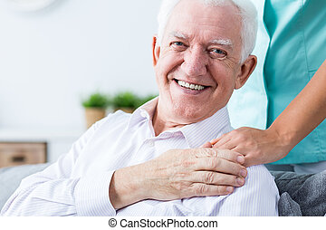 This is my professional helping hand - Smiling senior man...