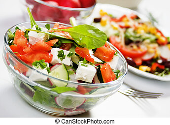 Delicious cheese salad with tomato, cucumber, radish and...