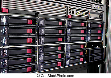 data storage rack - servers stack with hard drives in a...