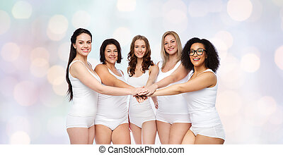 group of happy different women with hands on top - gesture,...