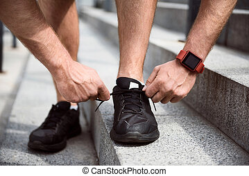 Man tying shoelaces on sneakers - Last preparations Picture...