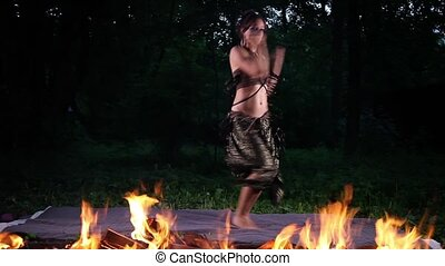 Woman Dance in Fire - Fast motion video shot of a beautiful...