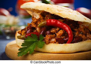 Mexican chili beans sandwich garnished with parsley and hot...