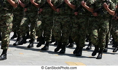 soldiers marching with rifles