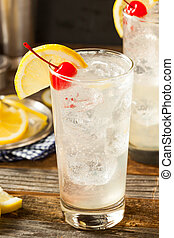 Refreshing Classic Tom Collins Cocktail with a Cherry and...