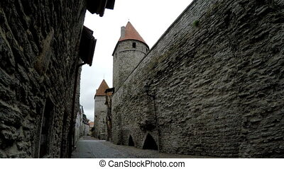 Street and tower of a city wall Old city Tallinn, Estonia -...