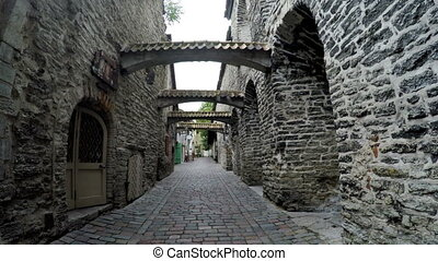 St. Catherine Passage - a little walkway in the old city Tallinn, Estonia,man and the woman go having joined hands