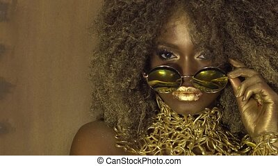 Magic surreal golden african american female model in...