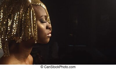 Side view of magic surreal golden african american female...