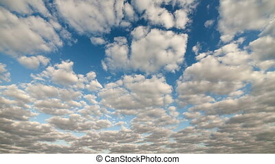 White clouds running over blue sky.