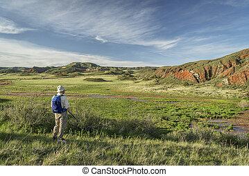 hiker at Colorado foothills - senior hiker at Colorado...