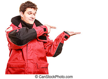 Young male showing gestures Man wearing weatherproof coat...