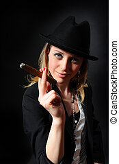 Girl with a cigar in a hand - Girl in a hat with a cigar in...