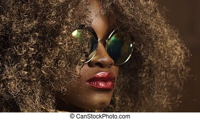 Close-up of magic golden african american female model