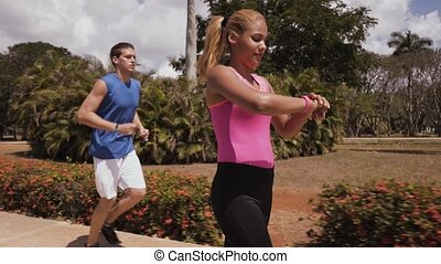 6-Slowmotion People Measuring Sports Activity With Fitband...