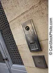 Intercom on a facade - Modern intercom on a stoned facade of...