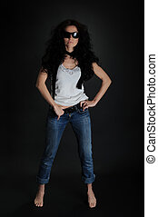 Girl in jeans and a hat full size on a black background