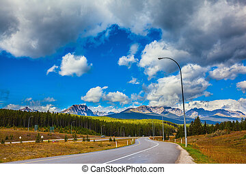 Perfect Canadian highway amidst evergreen forests and...