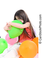 Girl embraces a balloon - Girl embraces a green balloon...
