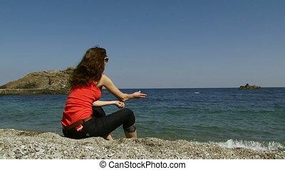 Woman on a rocky beach