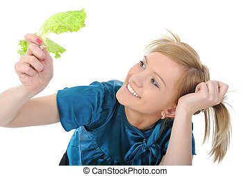 Beautiful girl with lettuce in her hand