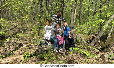 hiking family relax sitting in the forest