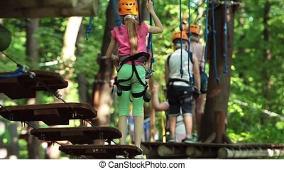 Kids rope park. Adventure activity in forest. Climbing on...