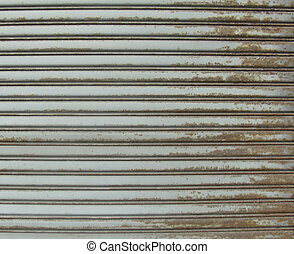 rusty metal store role shutter...