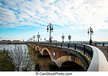 Old stony bridge in Bordeaux, France Europe