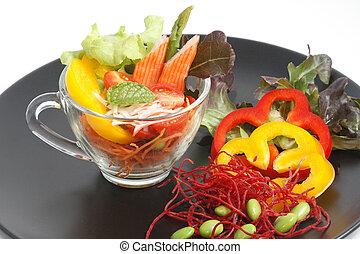Crab stick cocktail salad served in transparent glasses.