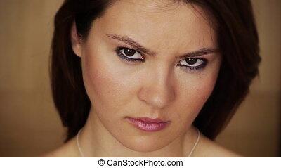 Angry young woman staring at camera