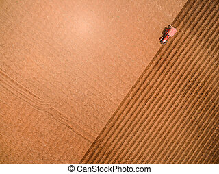 Aerial view of tractor on Prepare a field for planting, top...