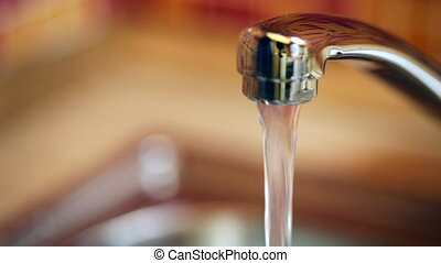 Pouring a glass with drinking water - Filling up a glass of...