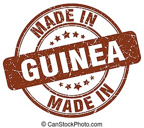 made in Guinea brown grunge round stamp