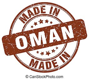 made in Oman brown grunge round stamp