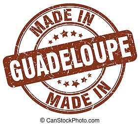 made in Guadeloupe brown grunge round stamp